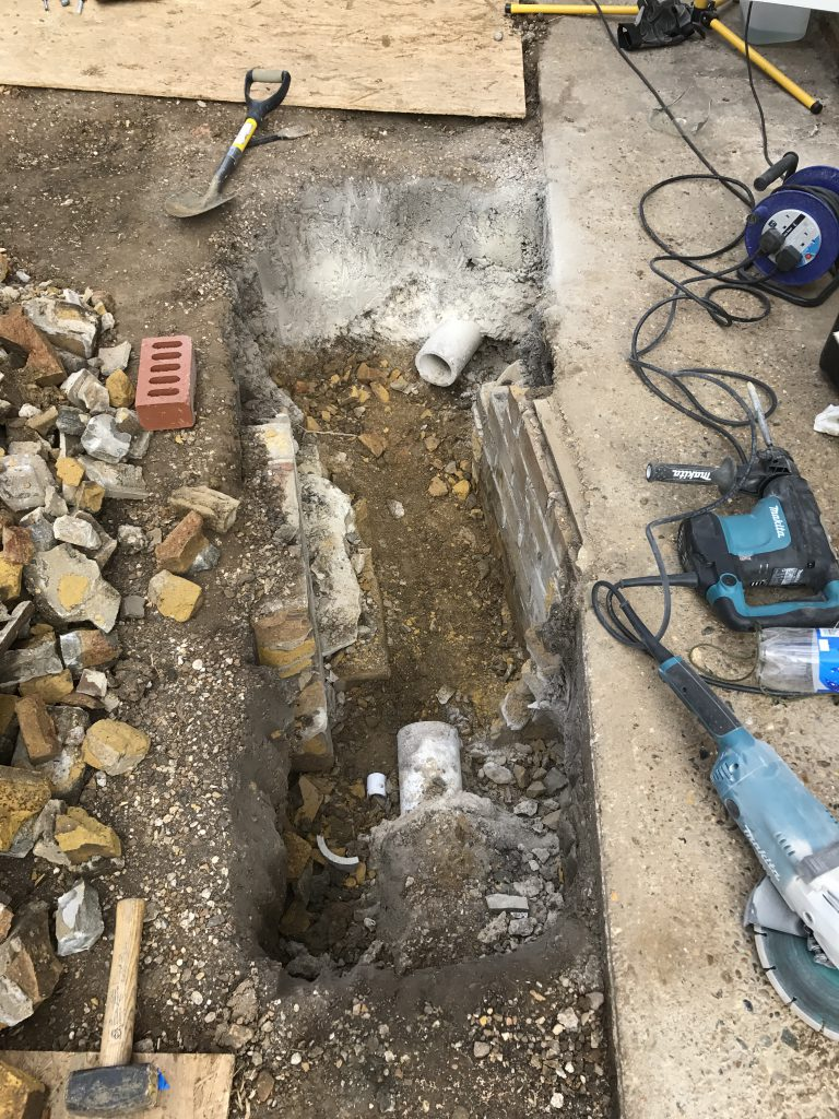 Old manhole removed ready for piping through